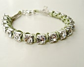 Handmade leather wrapped crystal bracelet. Clear crystals on silver, light chartreuse green leather. One size, adjustable.