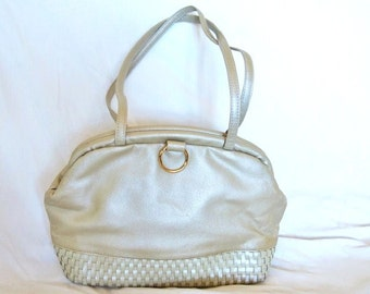 Metallic Bag in Excellent Condition Self Memory  Clossure Snap,  does not need a Clasp is Very 1970s