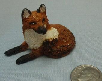 Handmade Miniature Sculpted Fox laying down.