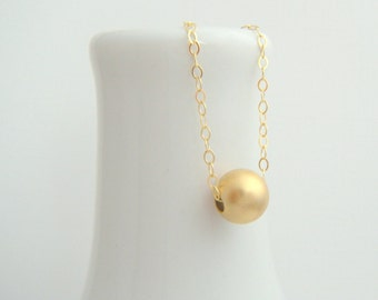 brushed gold ball necklace. 14k 14 k yellow gold filled bead. matte finish. round small dainty. simple everyday delicate jewelry 8 mm