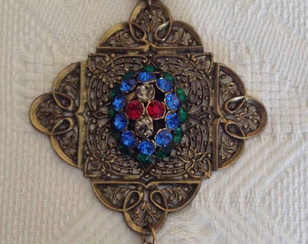 1960's, 18 inch long chain, with large brass filigree pendant