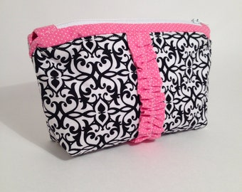Black, White, and Pink Ruffle Zipper Pouch