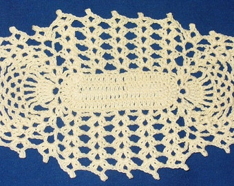 Small oblong doily with pineapple ends - crocheted