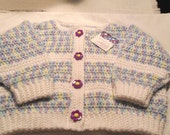 Girl's Crocheted Baby Sweater with Purple Flower Buttons