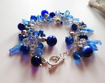 Blue bracelet.  Charm bracelet.  Crystal bracelet.  Cha cha bracelet.  Silver bracelet.