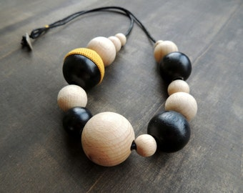 Black and natural wooden beads combined with crochet leather and a pebble