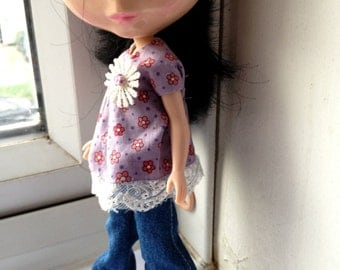 A gorgeous pair of blue flared jeans for Blythe