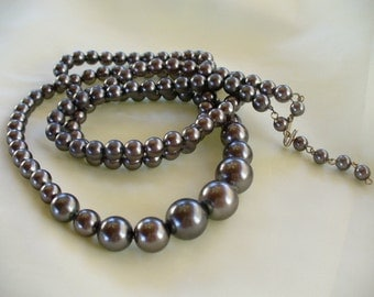 Long Strand of Black Pearls