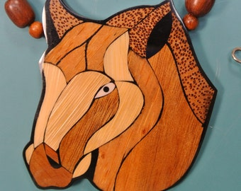 Gorgeous X-large handcrafted vintage 1970s coconut/ teak wood/ plastic horse pendant necklace in design by Lee Sands