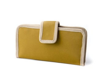 Two fold Wallet. Water resistant. Olive green softshell like fabric. 6 card slots, 2 wide slots, 2 zipper pockets.