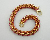 Chainmaille bracelet orange, gold, red, Jens Pind spiral rope tricolor anodized aluminum