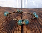 Blue beads with brown wire bangle bracelet