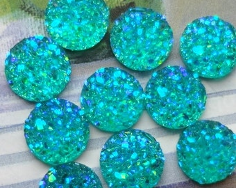 25pcs - 10mm - Rainbow AB stardust  - resin - cabochons -Teal zeal blue - different hues -