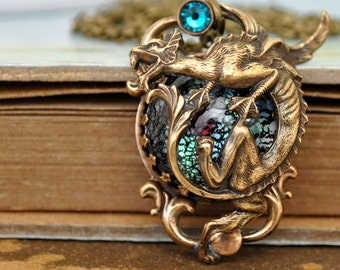 IN THE MIST, antiqued brass winged dragon necklace with vintage black opal color glass cab