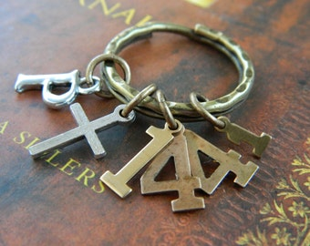 CHRISTIAN KEYRING, Scripture Gifts, PSALM 144:1- Praise be to the Lord my Rock, who trains my hands for war,  my fingers for battle.