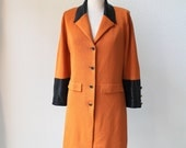 vintage St. John luxurious burnt orange knit evening coat.  embellished black sequin trim jacket