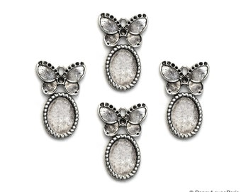 Set of 4.... Antique Silver Base Metal OVAL with Butterfly....Cameo...Cab...Extra Fancy... Flower....Frame Settings...Oval 14x10mm 20x30mm