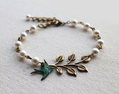 Leaf Branch with Sparrow Bracelet. antique brass leaves, swarovski pearls, and verdigris patina sparrow