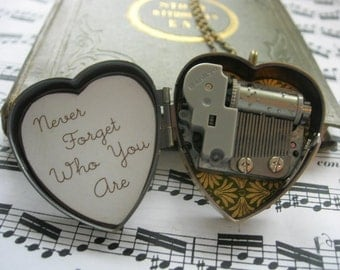 Little Wing tiny music box locket in green and gold