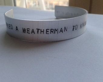 you don't need a weatherman to know which way the wind blows - Subterranean Homesick Blues - Bob Dylan -  Handstamped Bracalet