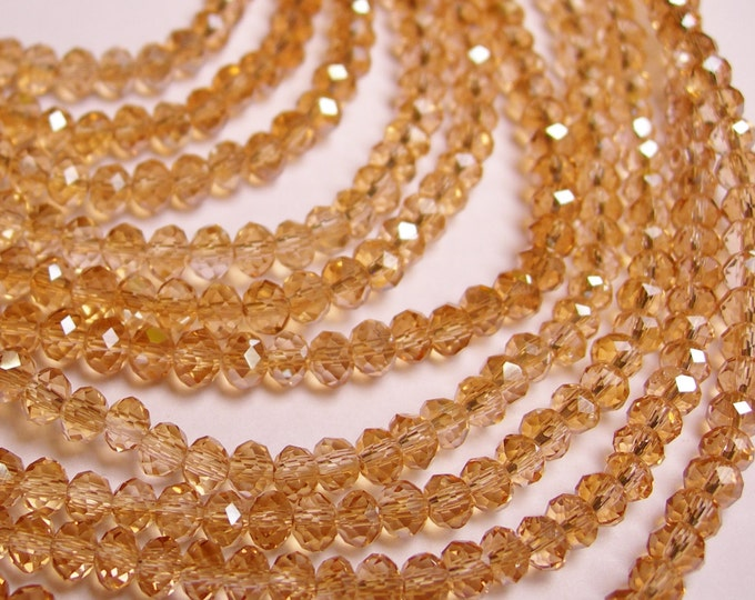 Crystal faceted rondelle - 100 pcs - full strand - 4 mm - A quality - light tangerine sparkle - FCRM37
