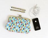 clutch purse. cosmetic bag. pencil case. drops on blue . kisslock purse