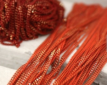 The shiny red and orange chains
