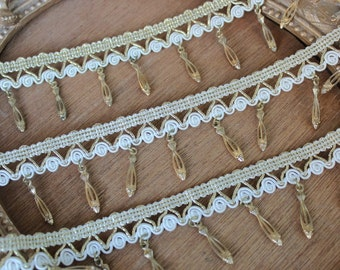 Very nice embroidered gold and with color  trim  with  hanging beats 1 yard listing 2 inch wide