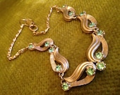 Chunky 1960s vintage cast goldtone metal and green rhinestone costume choker with greek key patterned chain