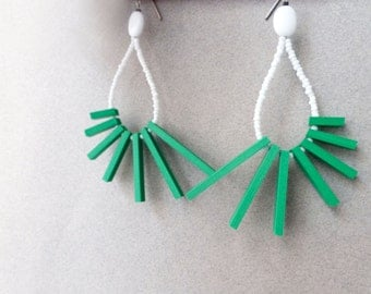 tribal geometric hoop earrings with green sticks and white beads, contemporary jewelry
