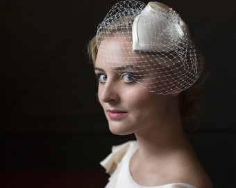 Ivory Teardrop Hat with a Birdcage Veil.  Wedding Fascinator Bridal Accessory in silk satin with french net
