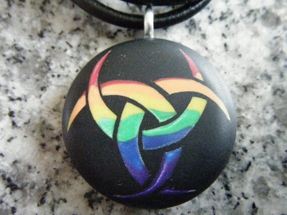 Rainbow Triple Goddess hand carved on a black color background. Pendant comes with a FREE 3mm leather necklace.