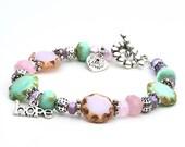 Garden of Beadin' - handmade pastel spring charm bracelet / women's glass bead & silver charity jewelry