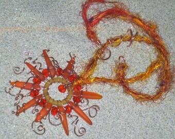 Solieta - wireworked, sea glass sun necklace on sari silk handspun yarn
