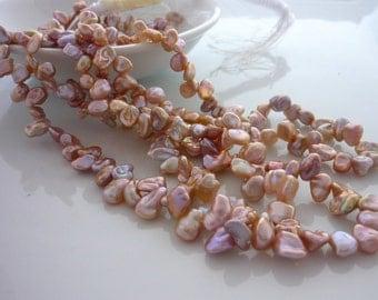 Gorgeous blush pink top drilled keshi pearls 5-8mm 1/2 strand