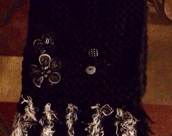 Hand knitted black scarf with embellishments