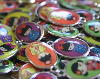 Kawaii Kokeshi Doll charms - 12 Metal and Glazed  Assorted Japanese Kokeshi doll charms