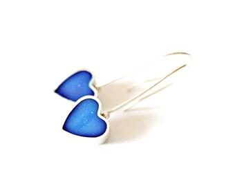 Sterling silver heart earrings with resin.
