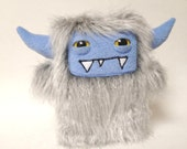Harvey: a grey shag faux fur plush monster