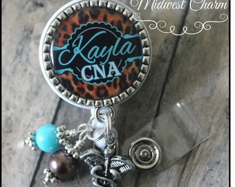 blue/cheetah .CNA..Personalized retractable badge reel with pinch clip..nurse..teacher...md..id holder..lanyard..bottlecap jewelry
