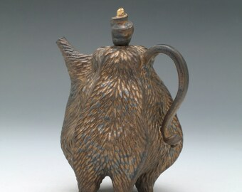 Textured porcelain teapot in bronze glaze with gold luster topped lid