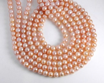 5-5.5mm off round freshwater pearls, one full 15-inch strand, grade AA+, natural light pink color