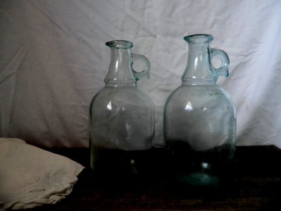 pair of vintage glass jugs . vintage decanters