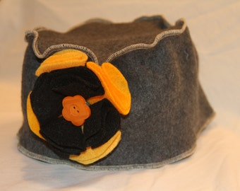 Grey Pillbox Hat Serged with Beige Edges and Yellow and Black Flower