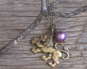 Majesty Antique Brass Regal Lion with Vintage Violet Faux Pearl Necklace
