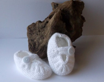 Hand knitted baby girls white strap shoes. 0 - 6 months.