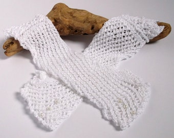 Women's or teenager hand knitted white lacy wrist warmers / fingerless gloves. Wedding accessory.