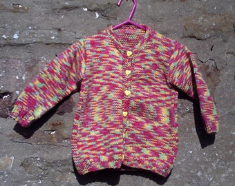 "Hand knitted girls multicolored, self patterning cardigan.  22"" chest. Pink yellow blue and green."