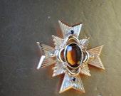 Classy vintage 80s gold tone metal maltese cross brooch- pendant. Made by Avon.