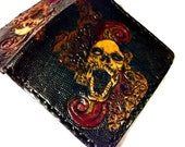 A Leather Biker Wallet is a perfect gift for a biker. Made to be tough and durable! Check out the embellished skulls! Holds 8 Cards,1 Slot